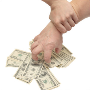 "alt=""Two hands: one grabbing a pile of cash, the other holding wrist"""