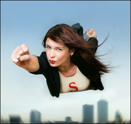 "alt=""Hopeful woman flying as Superwoman, in business suit"""