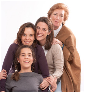 "alt=""Four generations of women from the same family posed to show life stages"""