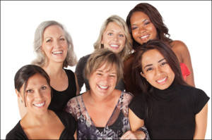 "alt=""Group of 6 Women of diverse ages and ethnicity, smiling and standing close together"""