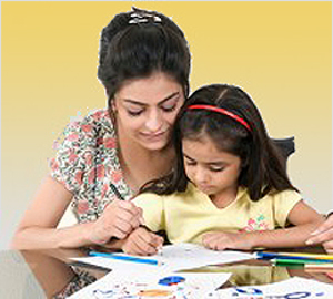"alt=""Devoted mother helping her daughter with homework"""